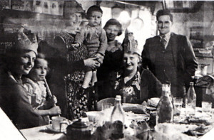 Christmas at Central Stores, Deighton, Yorkshire, in 1937. The writer can be seen sitting on her mother's knee on the left