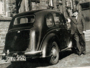 Dad poses proudly with his shiny black pre-war Austin before cramming everything into go to Swinderby in Lincolnshire.