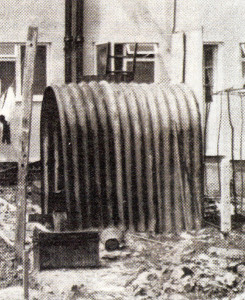 An old Anderson air-raid shelter kept on as a garden shed in the 1950s.