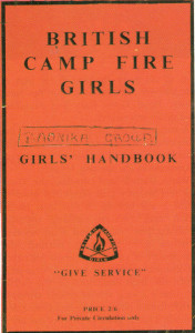 The British Camp Fire Girls' Handbook, with the motto 'Give Service'.
