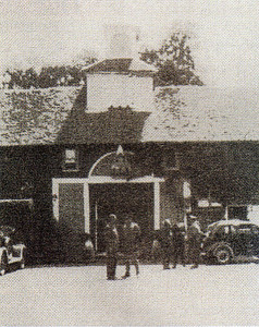 The Army tells the author's father (on left) of its plans for the use of his premises in 1940.