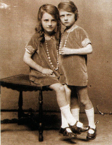 The writer (standing) and her sister in the late 1920s.