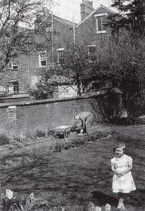 In the walled garden at Oxford in 1933. No mud pies today, because Daddy is in the background!